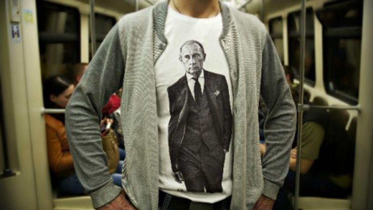 Man wearing a Putin T-shirt in Moscow's underground