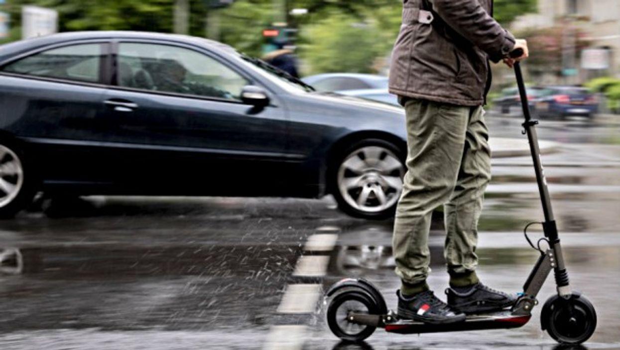 Marcel Hutfilz, managing director of Scooterhelden on the streets of Berlin.