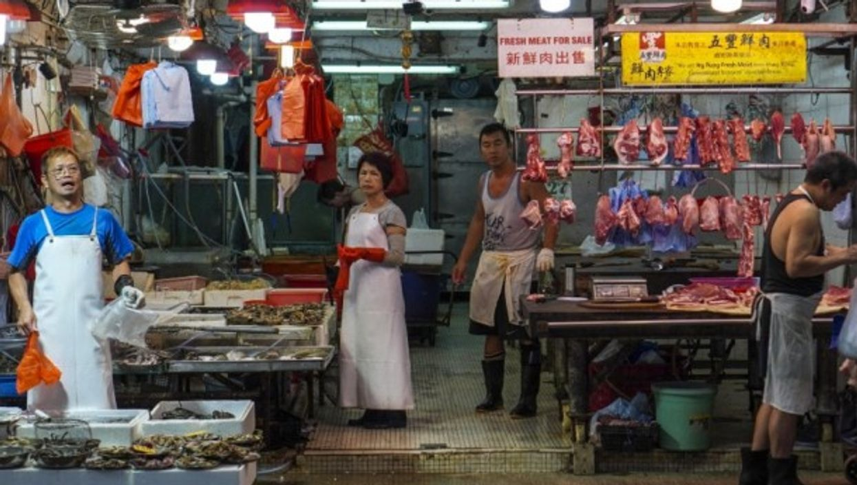Meat and seafood stalls at the North Point Wet Market in Hong Kong.
