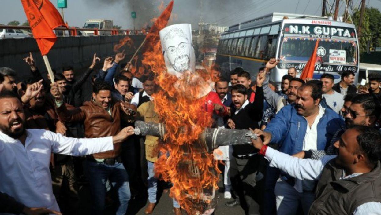 Members of India's Rajput community shout slogans against film director Sanjay Leela Bhansali in protest