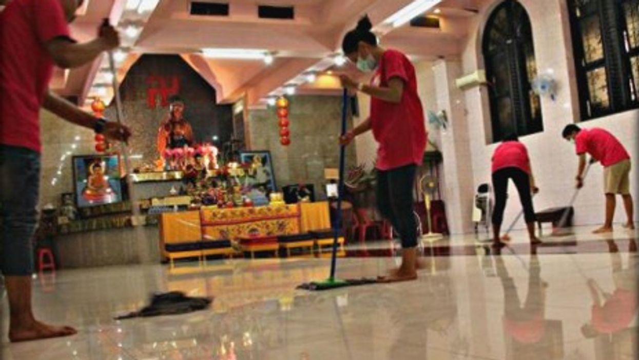 Members of the berhati group cleaning up a Vihara in Jakarta.