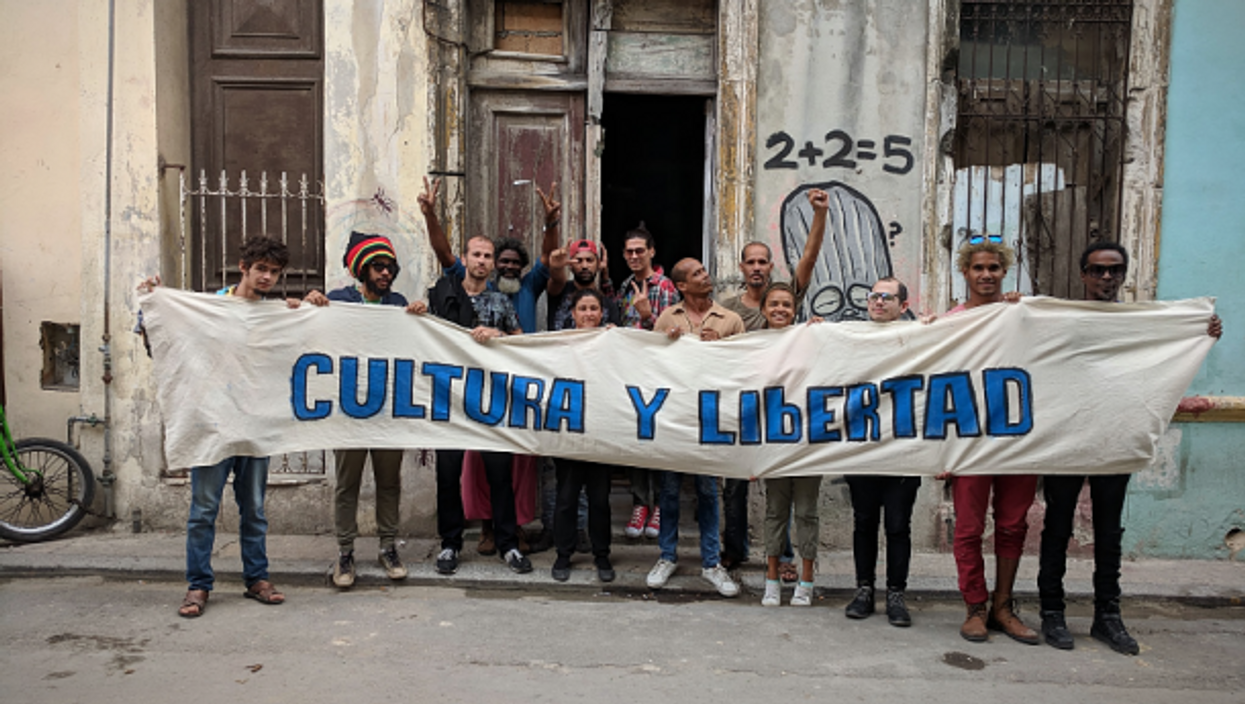 Members of the San Isidro movement hold up a banner reading 'Culture and Liberty'