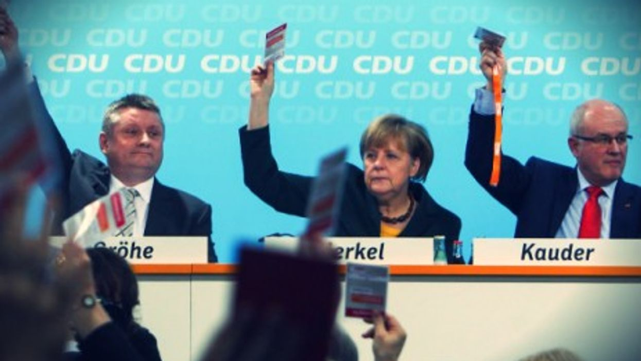 Merkel and her allies voting for another coalition government in 2013