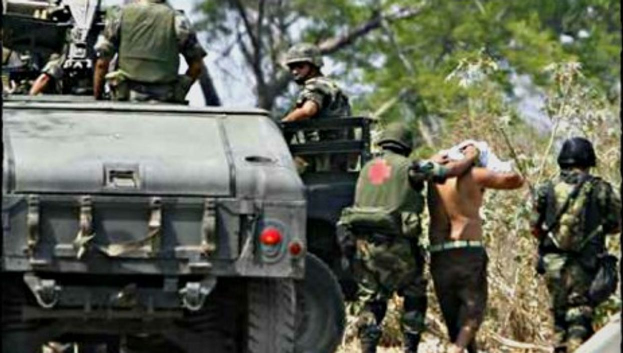 Mexican soldiers arresting cartel suspects in southwestern Mexico