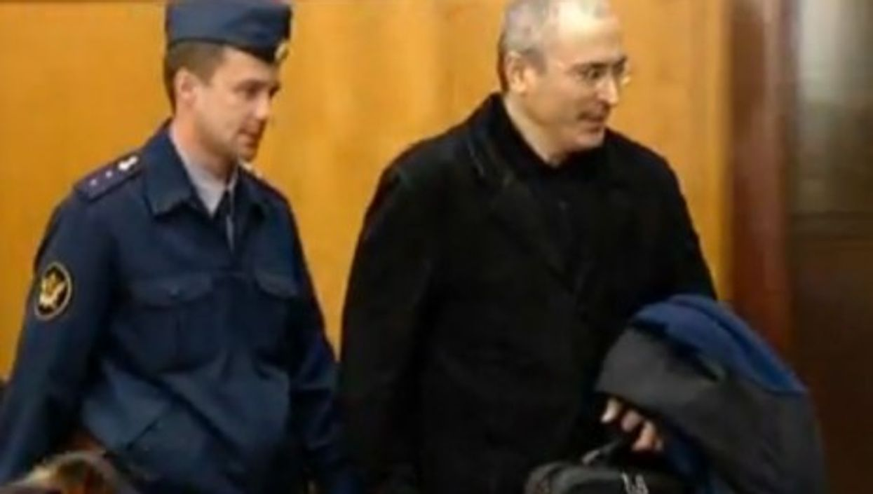 Mikhail Khodorkovsky being led into court during his second trial.