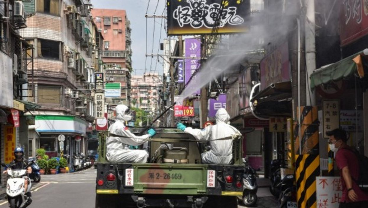Military groups are conducting disinfection missions in Taipei, Taiwan.