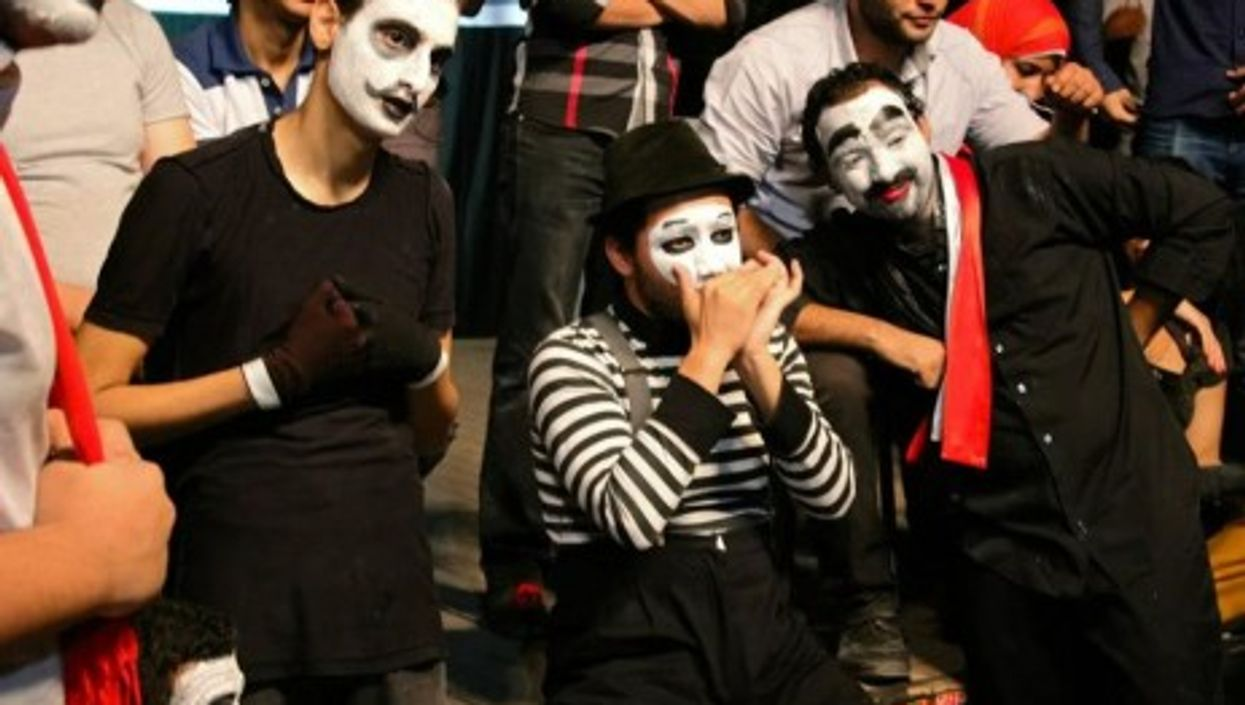 Mimes perform in public