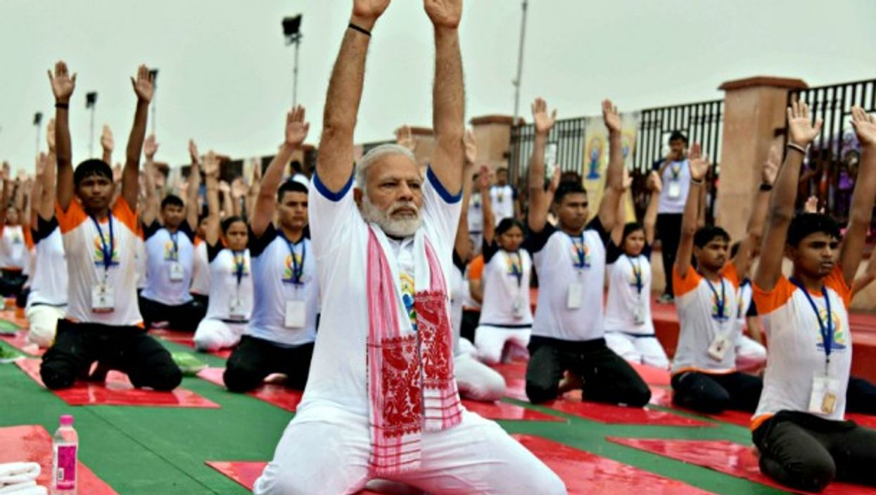 Modi participating in a mass yoga demonstration in Lucknow