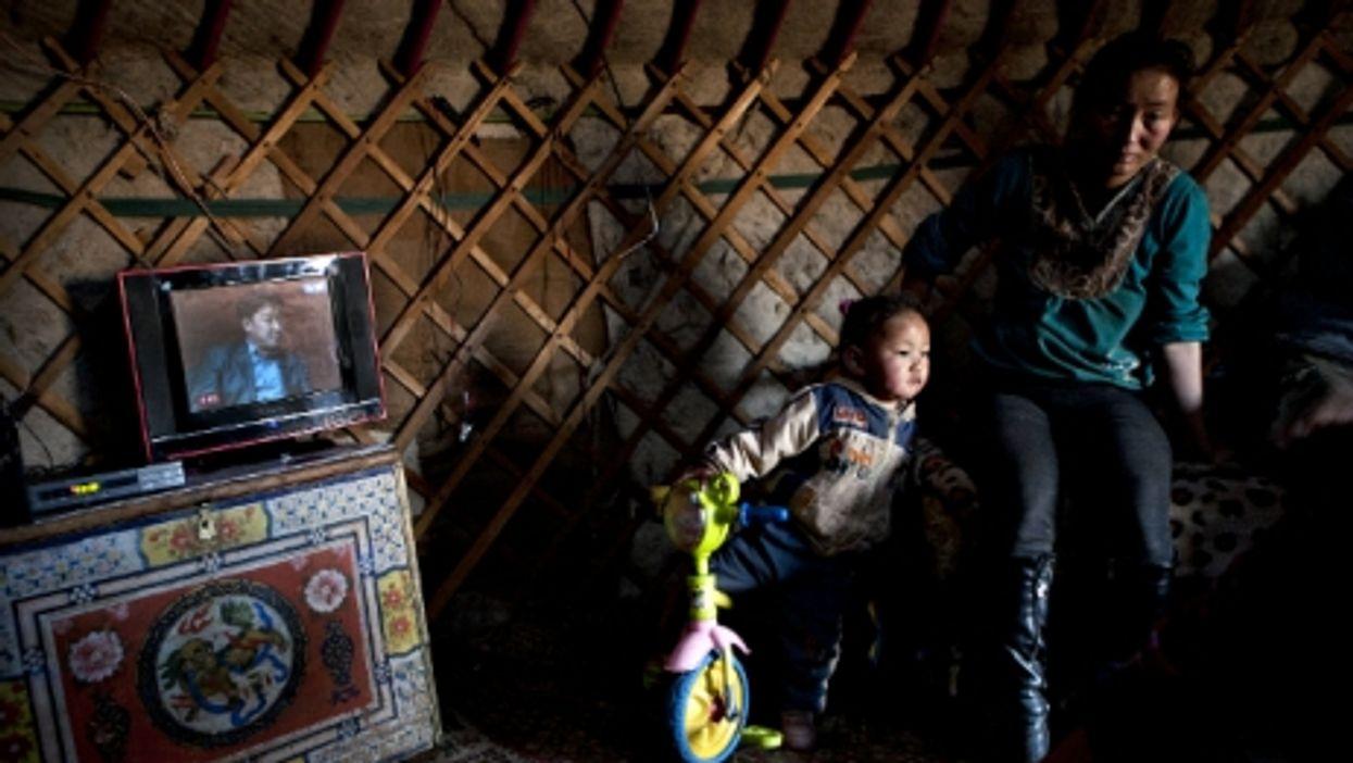 Mongolian family inside a traditional ger (yurt) in the Gobi desert