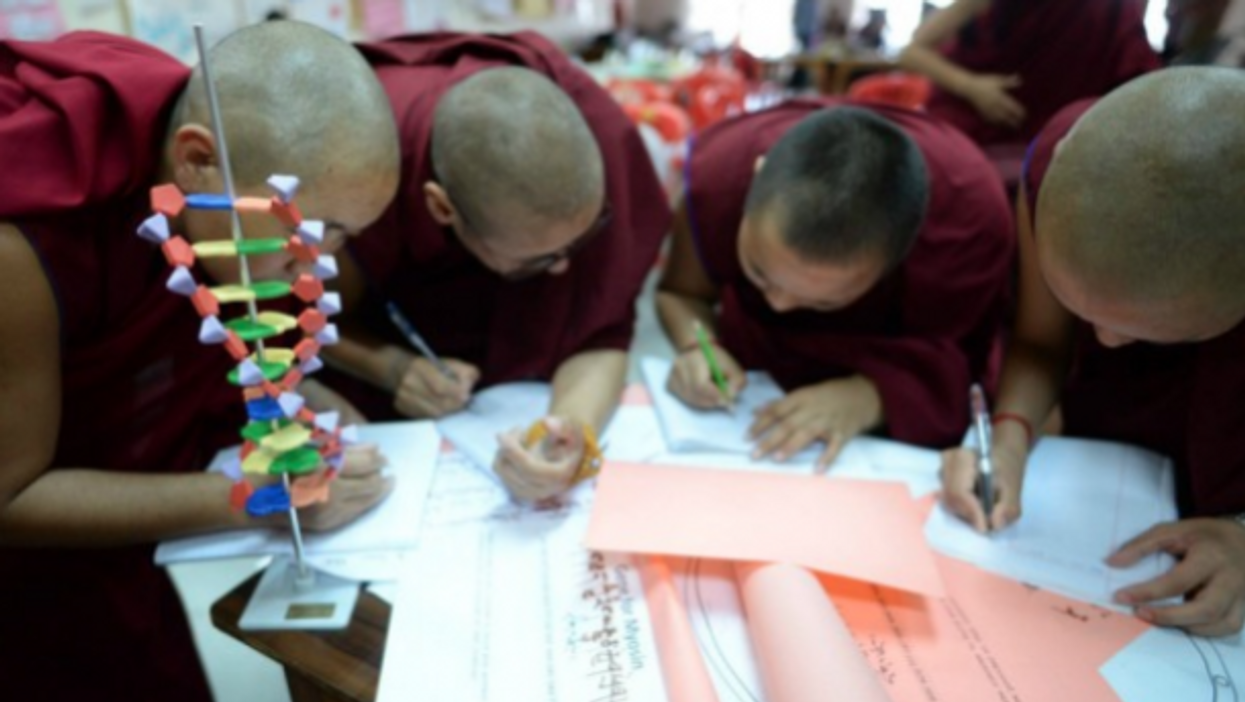 Monks working on a project with Science for Monks