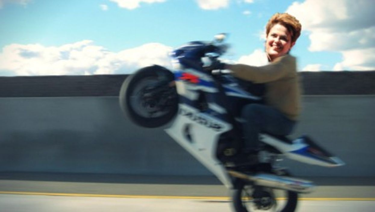 Montage, obviously: Dilma had her helmet on