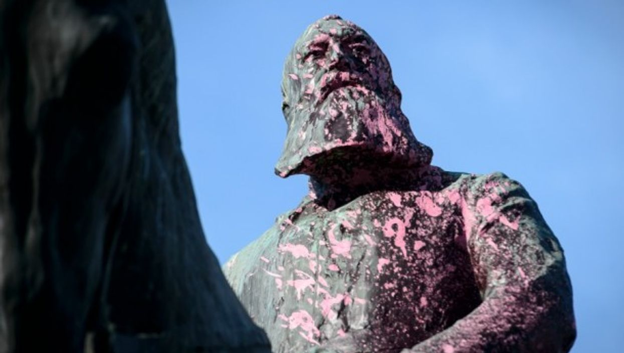 Monument of King Leopold II in Brussels paintbombed with pink paintin 2018.