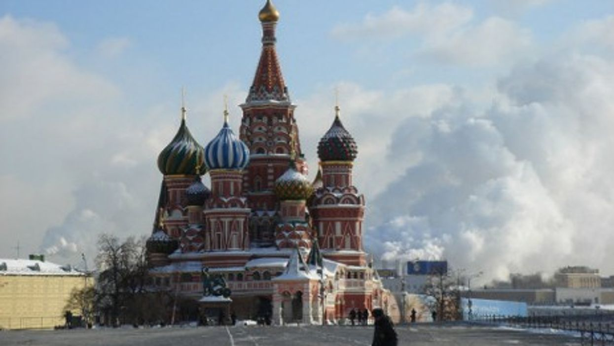 Moscow's St. Basil cathedral surrounded by incinerator smoke.