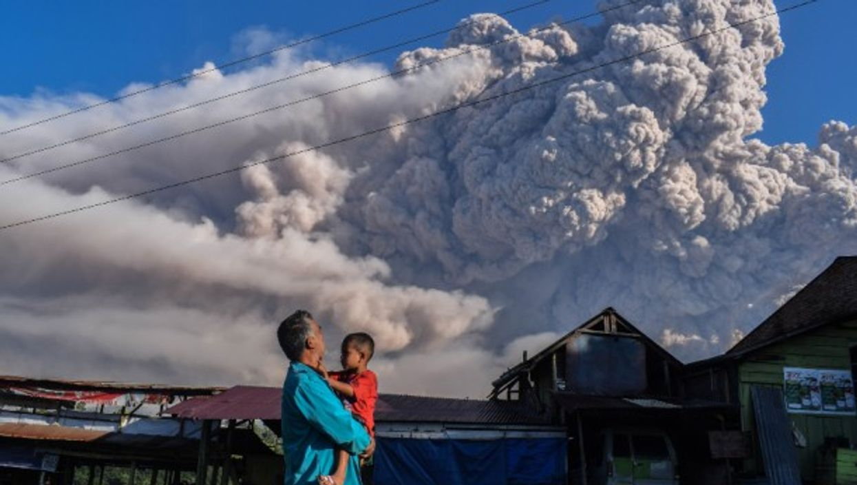 Mount Sinabung spews volcanic material during an eruption in Karo, Indonesia.