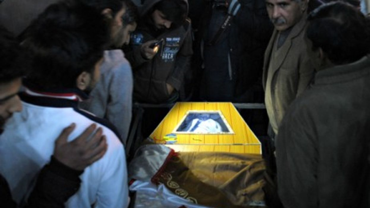 Mourners attend the funeral of a student who was killed in Tuesday's attack by Taliban gunmen on a school in Peshawar