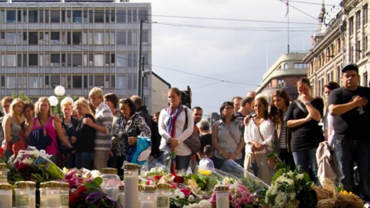 Mourners gathered in front of the Cathedral in Oslo, Norway