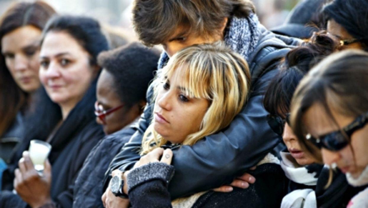 Mourners near Paris' Bataclan concert venue on Nov. 15