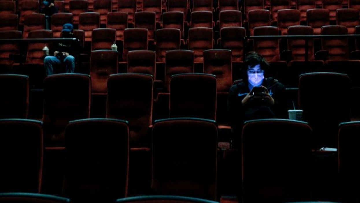 Moviegoers at the AMC Theater on the first day of reopening for theaters which had been closed due to the COVID-19 pandemic in Burbank, California