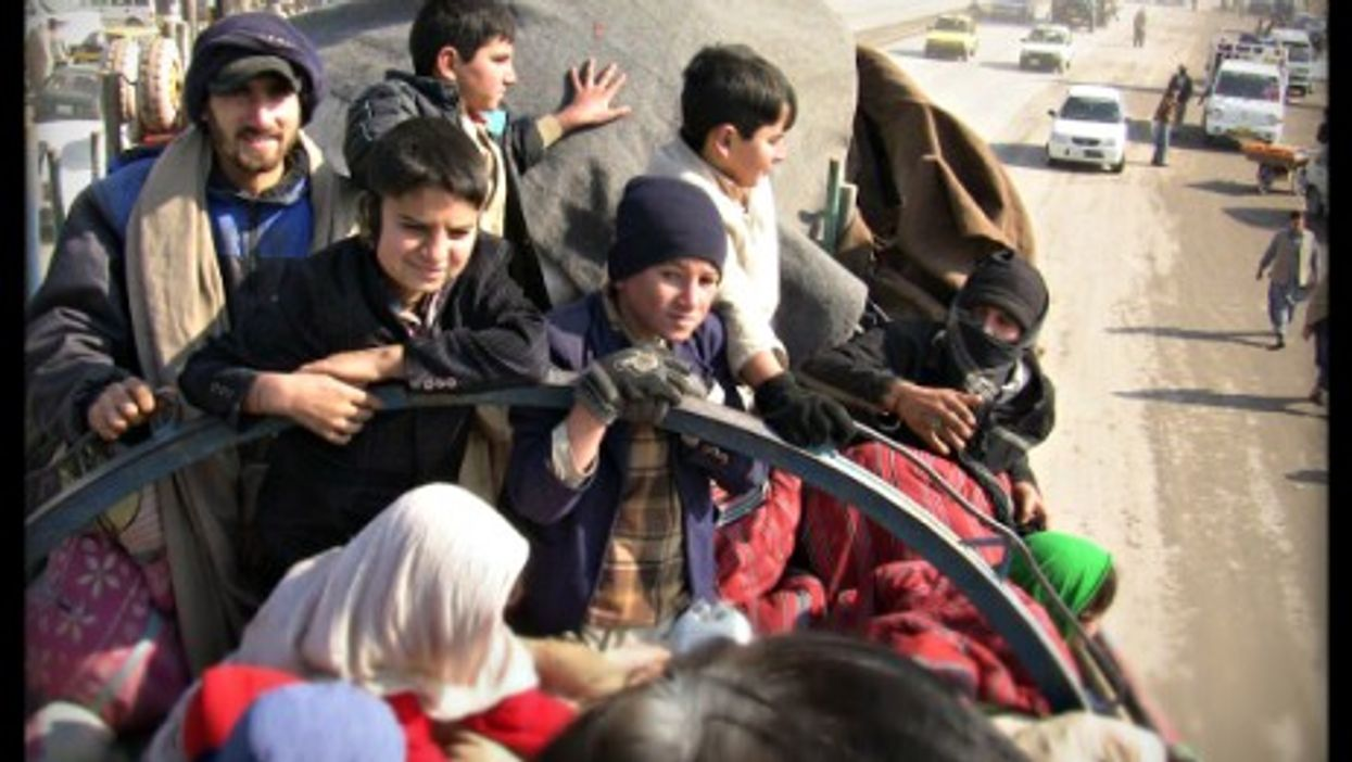 Muhammad Sadiq and his family on a truck to Jalalabad