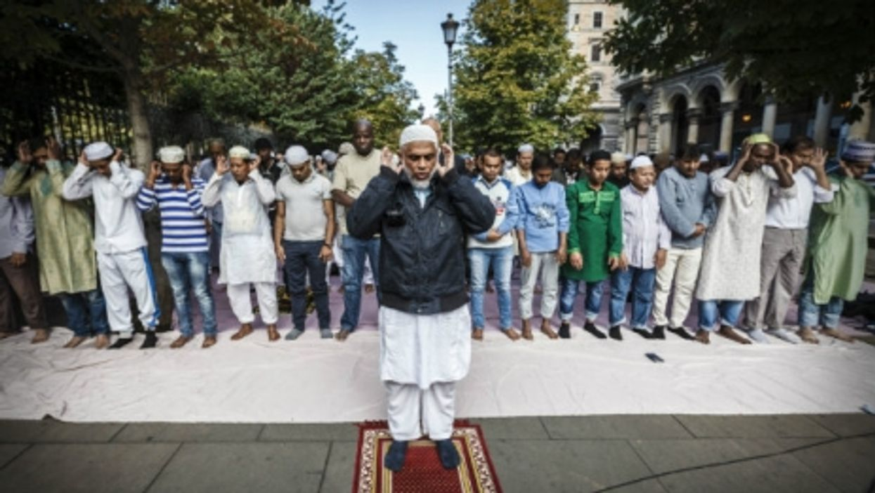 Muslims devotees attend a morning street prayer in Rome