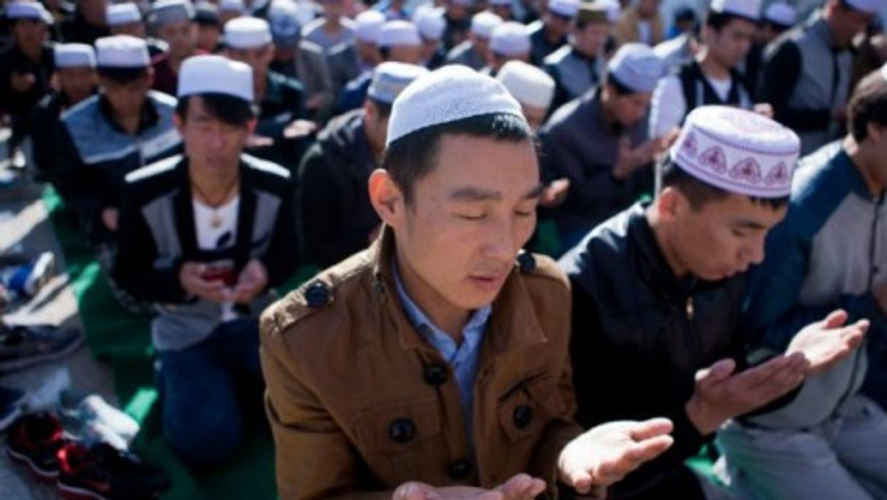 Muslims pray at a China mosque Sunday during the Eid al-Adha festival.