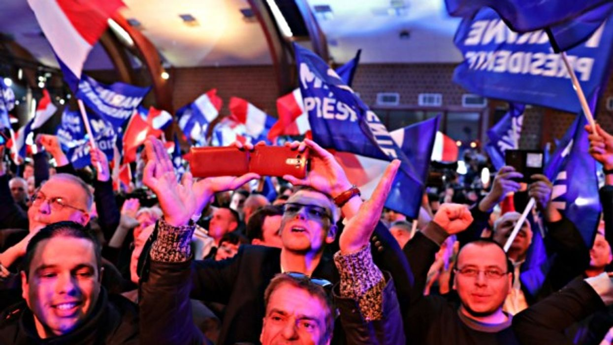 National Front supporters rally in Henin-Beaumont on April 23