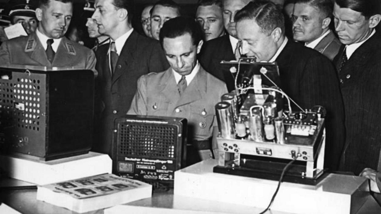 Nazi propaganda chief Joseph Goebbels (center) checking radio devices in 1938