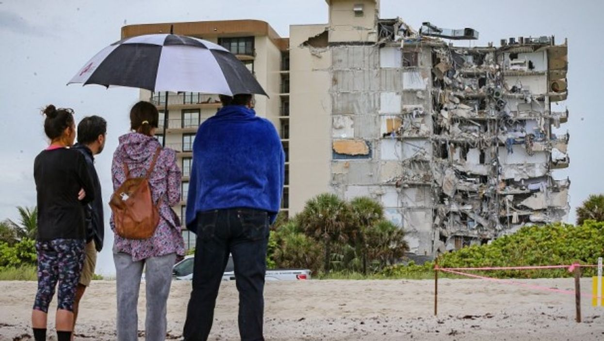 Neighbors look at rumble of a 12-story Miami building after its partial collapse