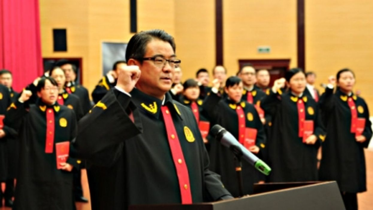 New judges of Guizhou Provincial Higher People's Court take oath