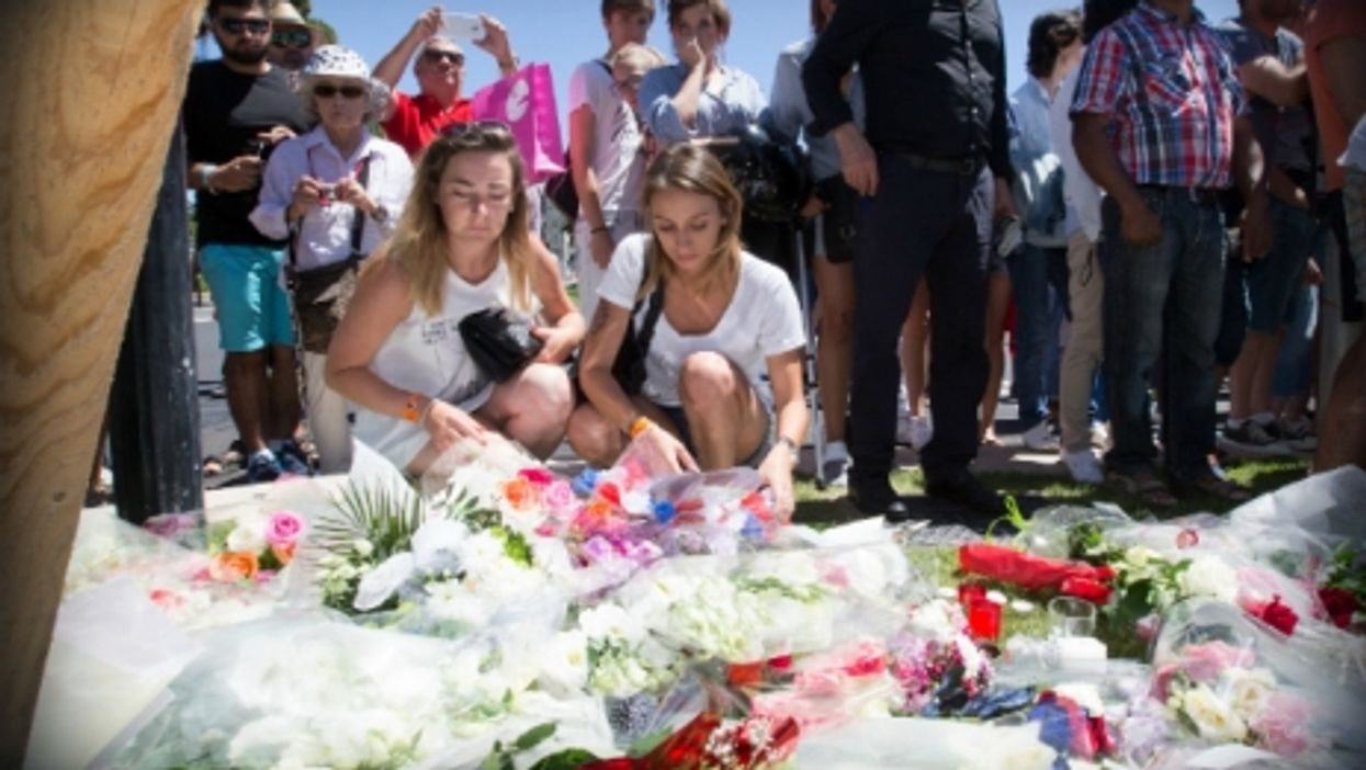 Nice residents lay flowers for the victims of the July 14th attack