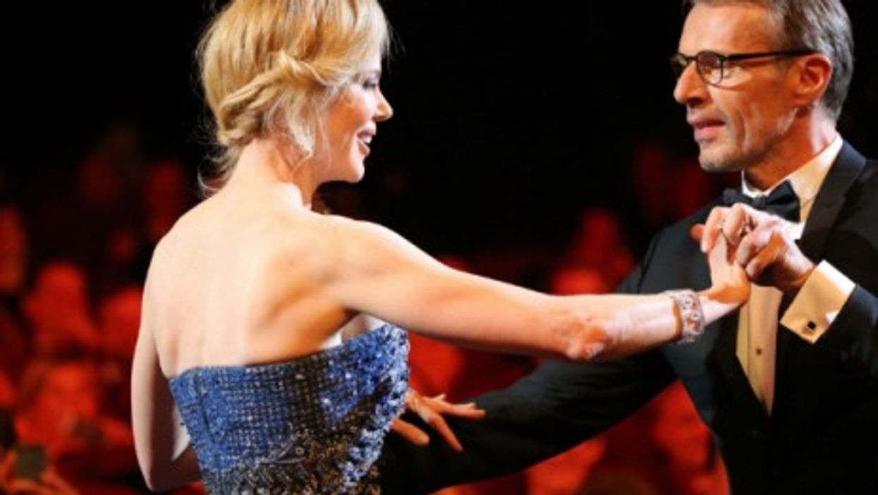 Nicole Kidman and Lambert Wilson dance briefly during the opening ceremony of the 67th Cannes International Film Festival