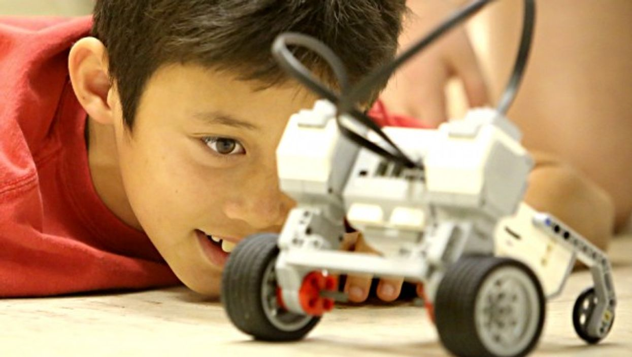 Nine and ten-year-olds test the RoverBot they worked on in an introduction to LEGO Mindstorms