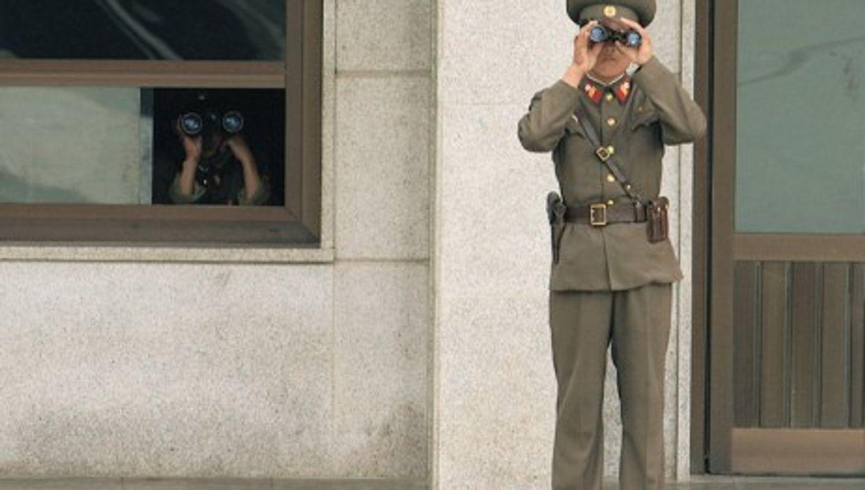 North Korean guard looking south