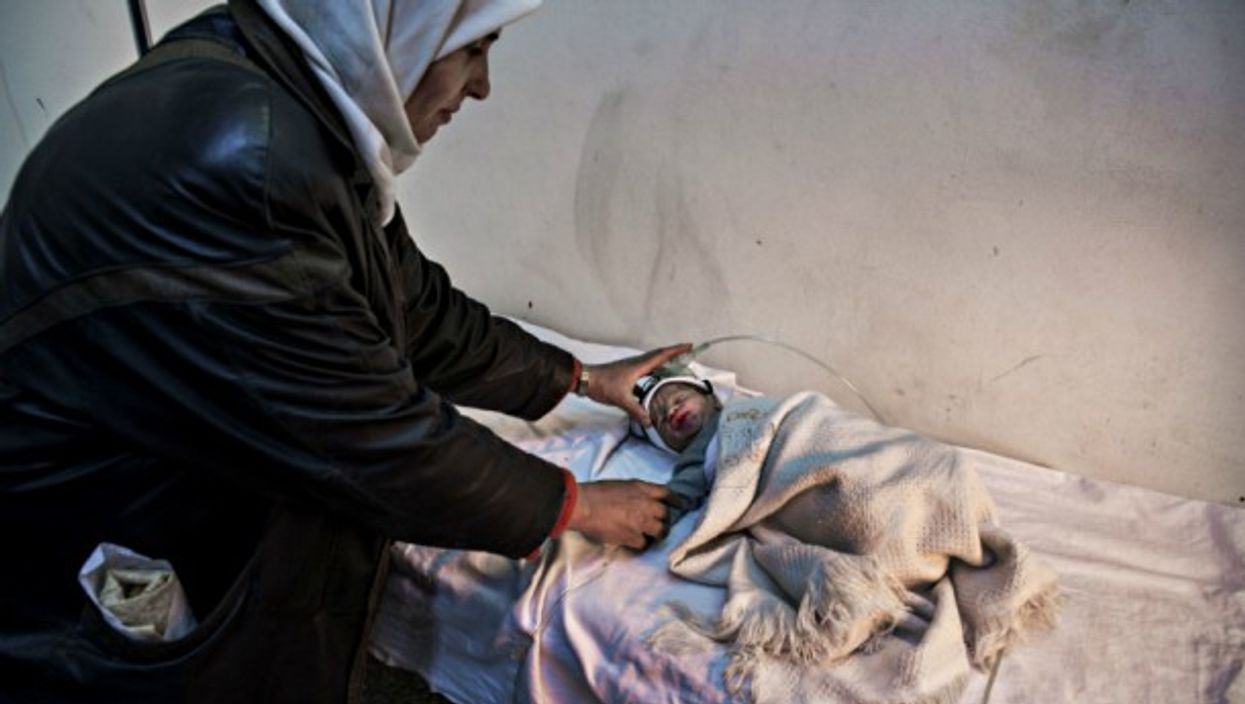 Nurse and baby at a hospital in Yabrud, Syria