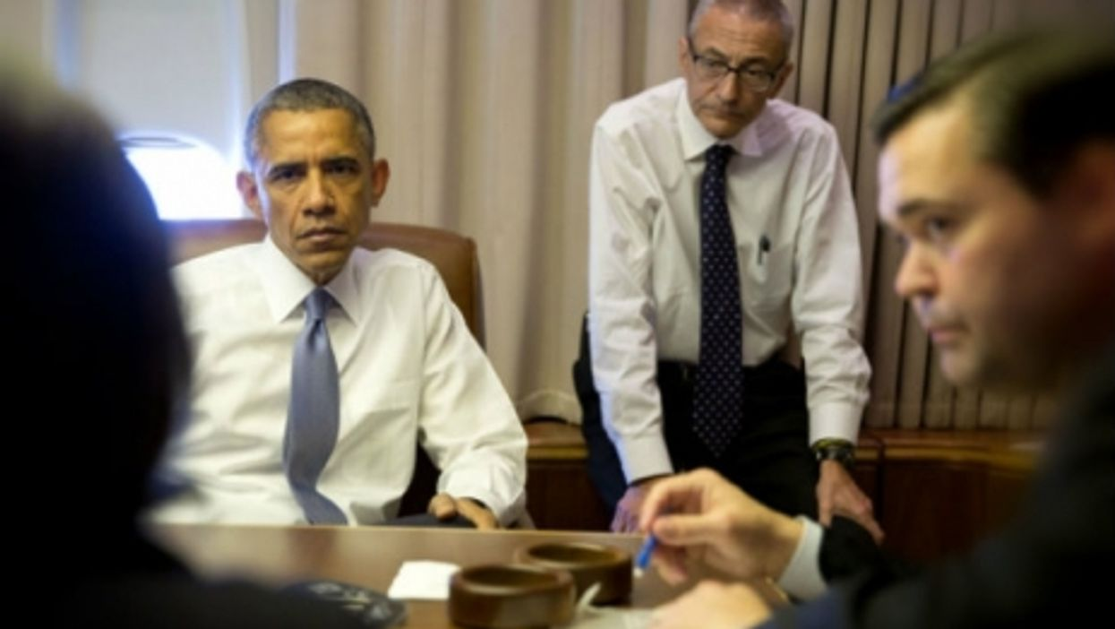Obama and top advisors on Air Force One.