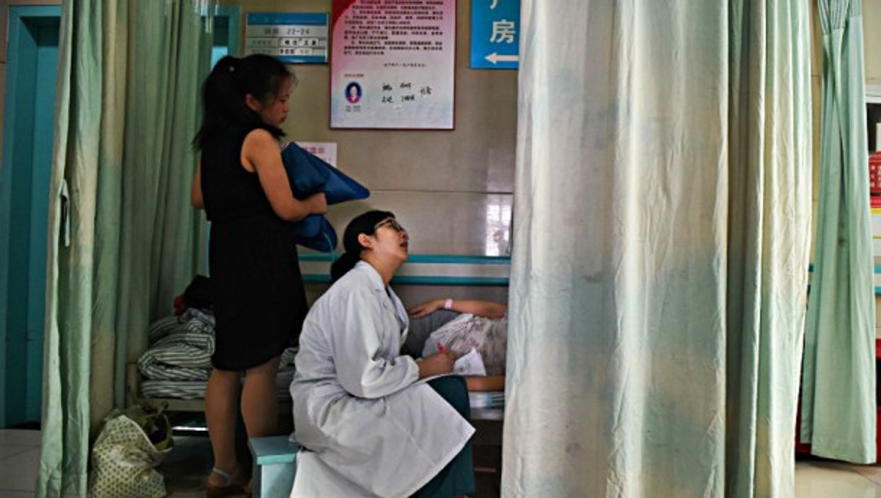 Obstetrician inspects a pregnant woman in Hefei, China