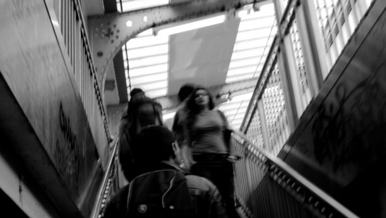 On the narrow stairs in the Paris metro.