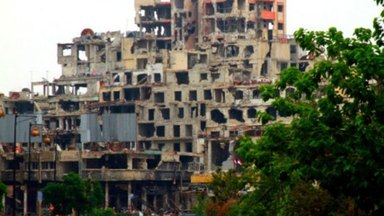Opposition forces have evacuated a ruined Homs.