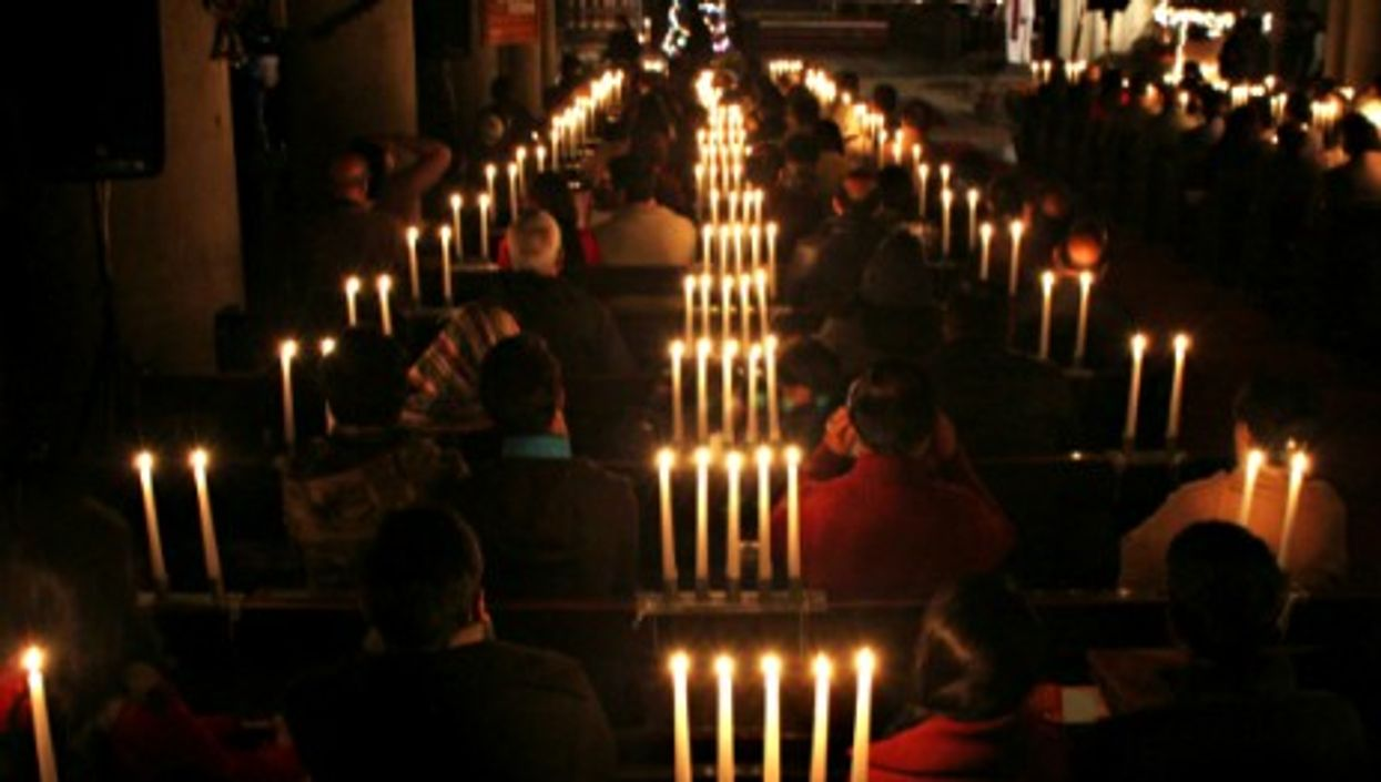 Pakistani Christians in Lahore praying for the victims of the Peshawar school massacre.