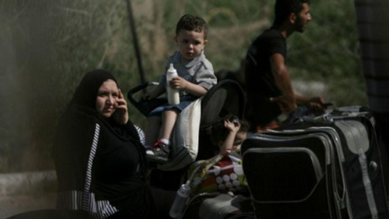 Palestinian Family At Rafah Border Crossing