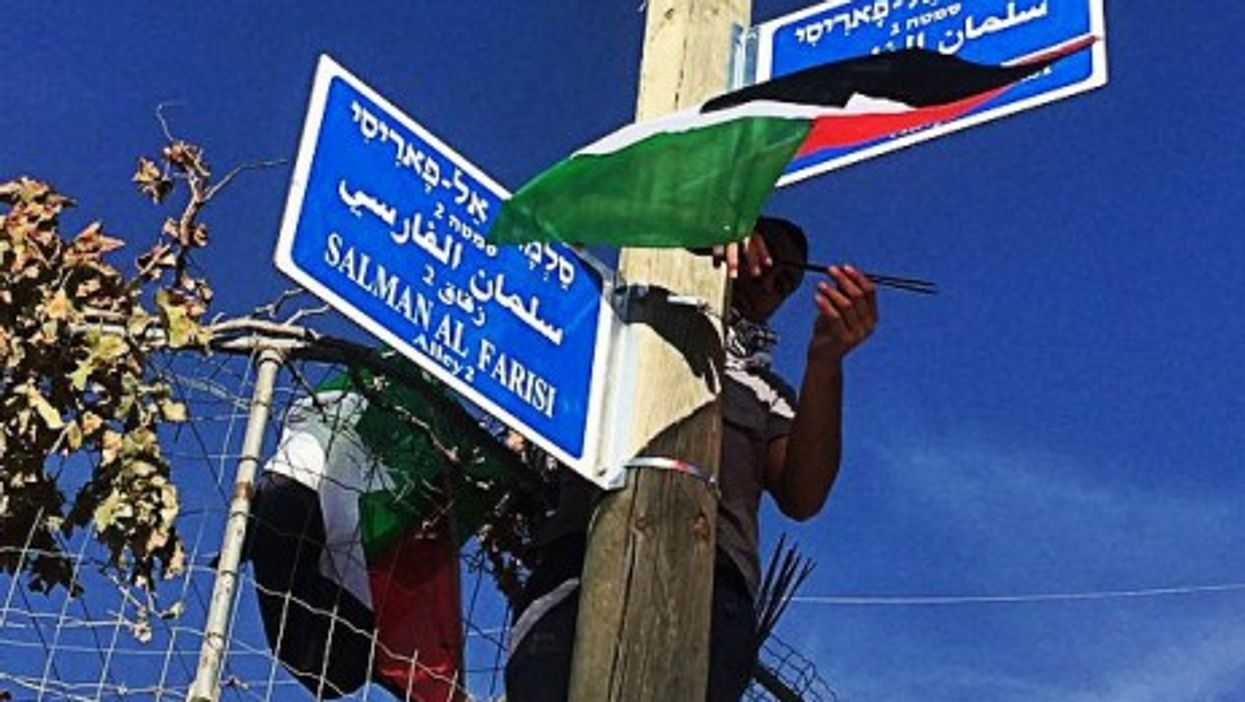 Palestinian flags are draped on electrical poles
