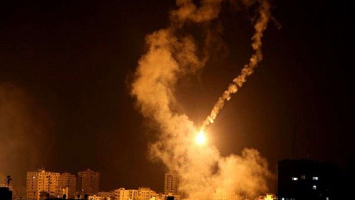 Palestinian houses lit up by Israeli light flares early Tuesday