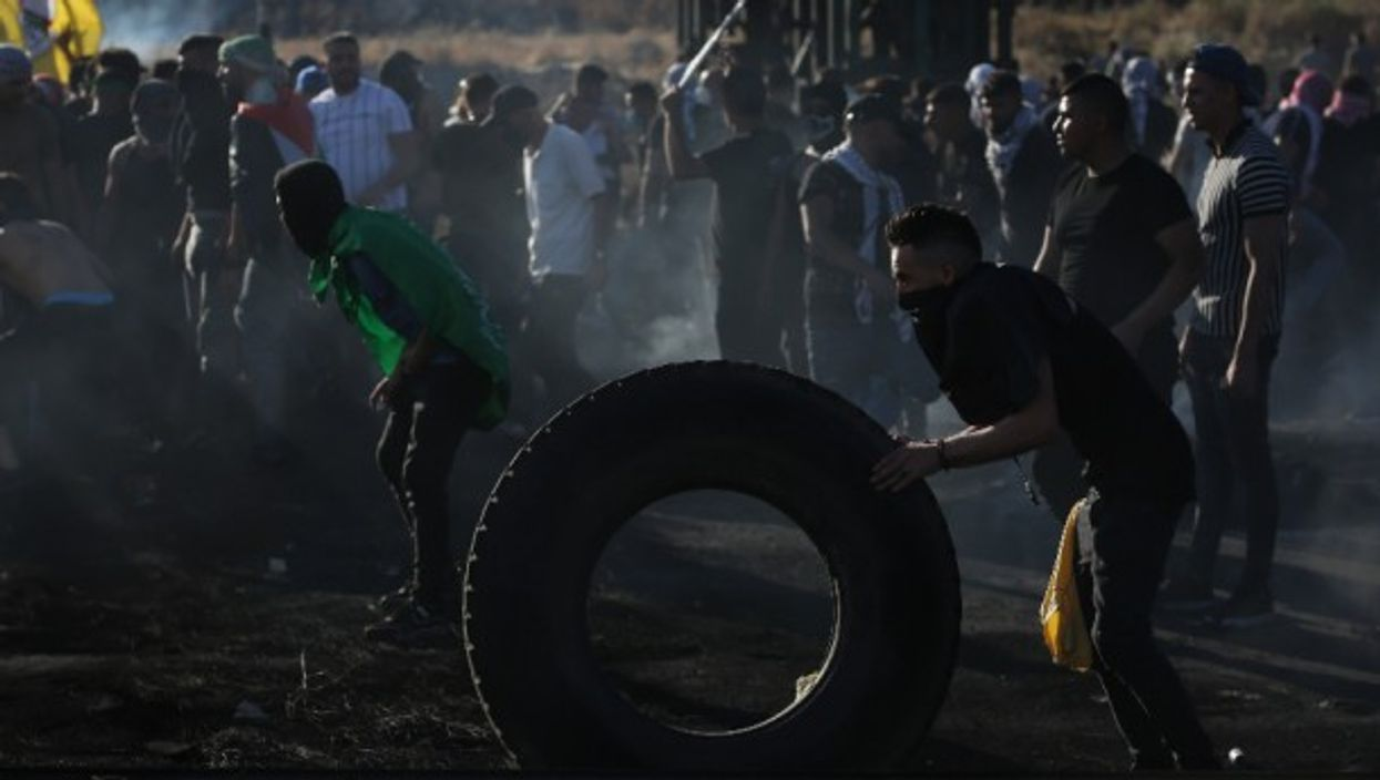 Palestinian protesters clash with Israeli soldiers near Nablus in the occupied West Bank