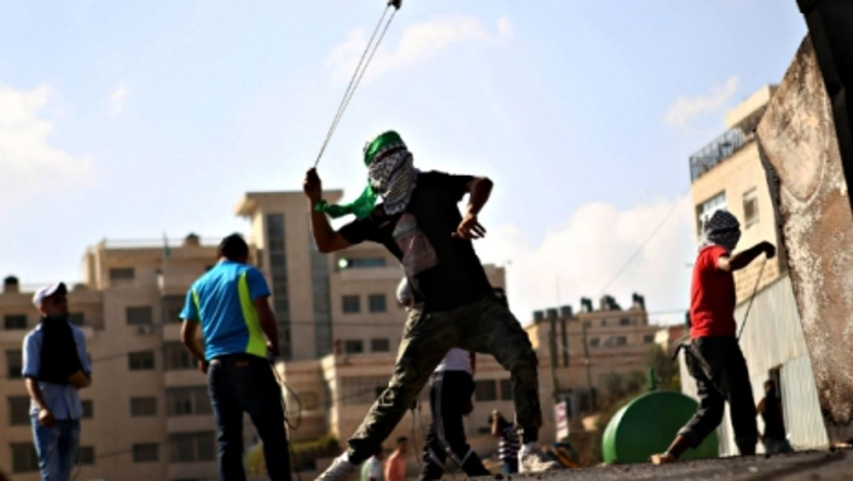 Palestinian protesters during clashes near Ramallah on Oct. 14
