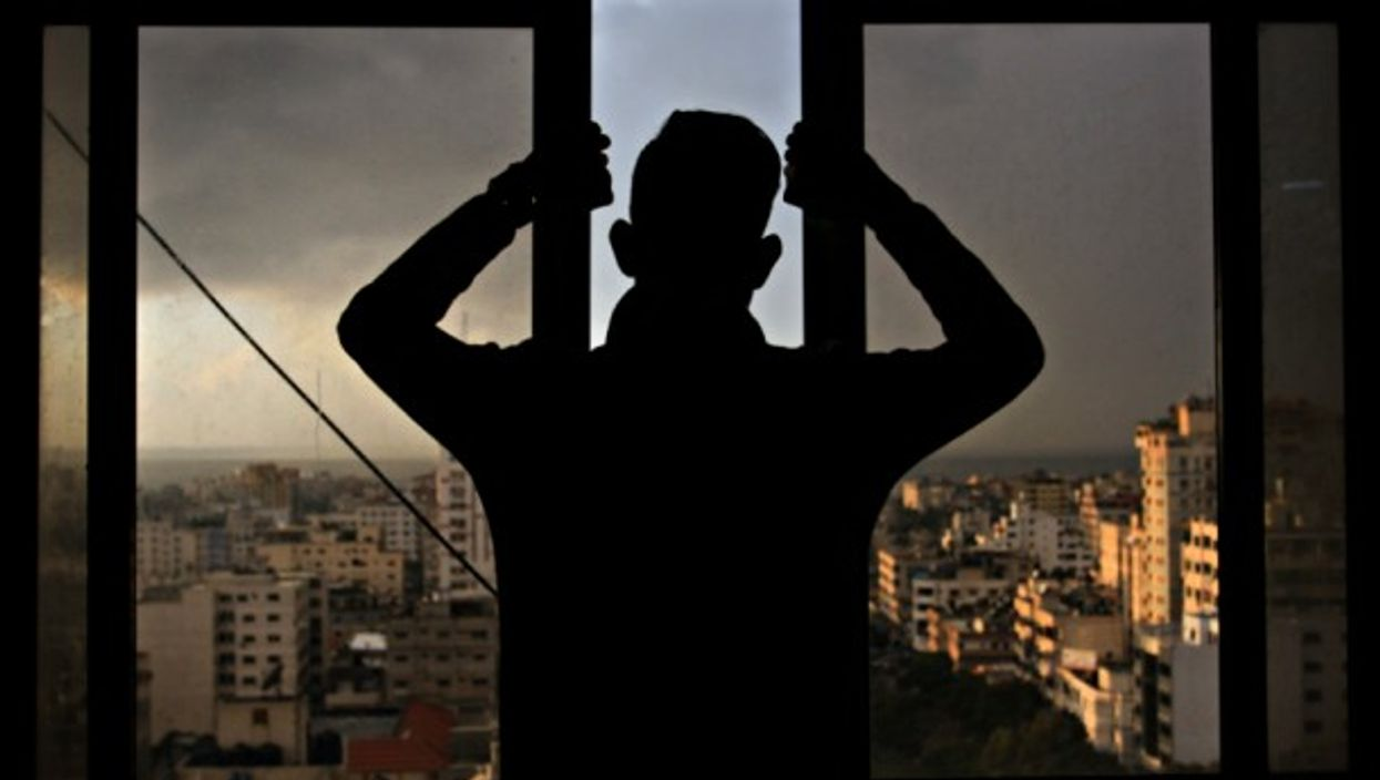 Palestinian youth looking over Gaza City