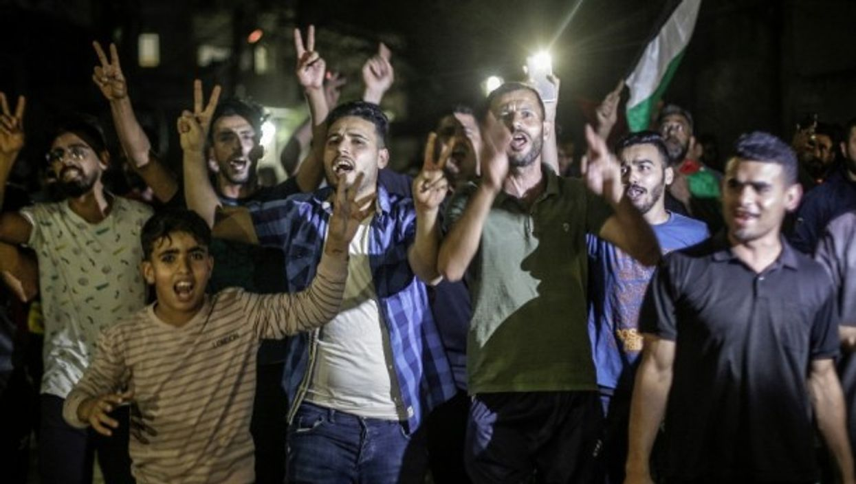 Palestinians celebrate the ceasefire in the streets of Gaza, after 11 days of open warfare with Israel.