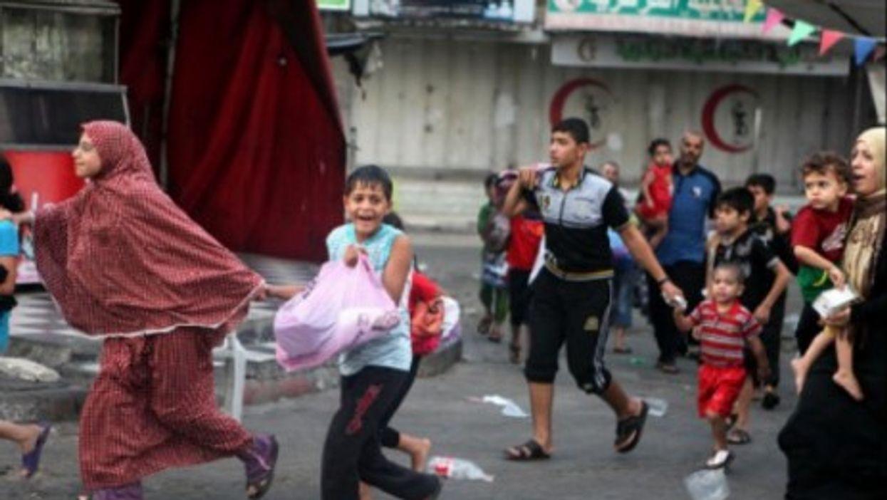 Palestinians flee the Shujayeh neighborhood during heavy Israeli shelling in Gaza City.