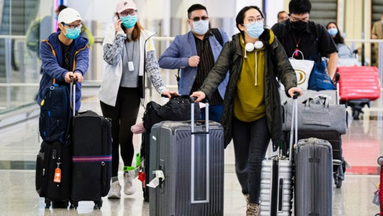 Passengers at the Hong Kong International Airport