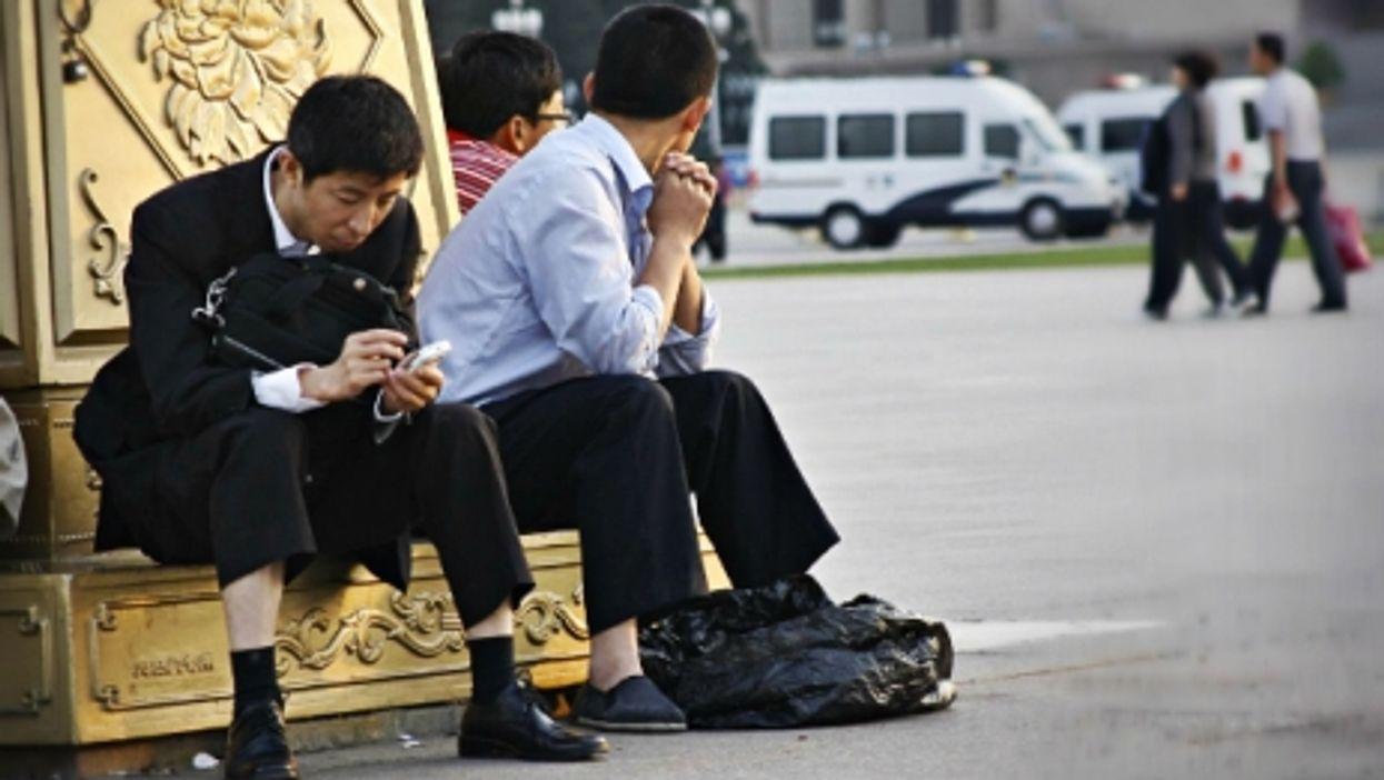 Passing time in Beijing's Tiananmen Square