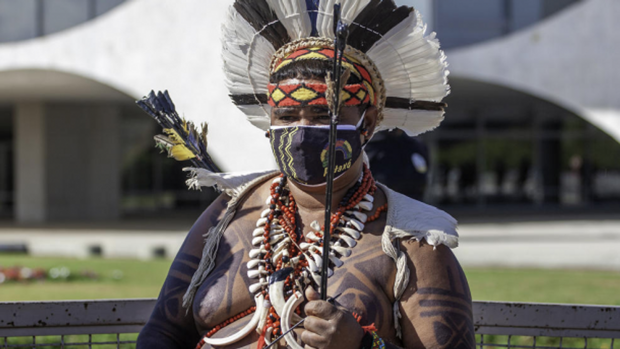 Pataxos Indian protesting a bill by Brazil's government to defend the demarcation of lands.